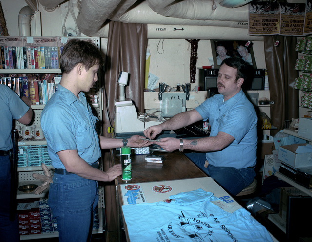 Ship's Serviceman SEAMAN Bret Burrow workd in the ship's store aboard the aircraft carrier USS SARATOGA (CV 60) during operations off the coast of Libya