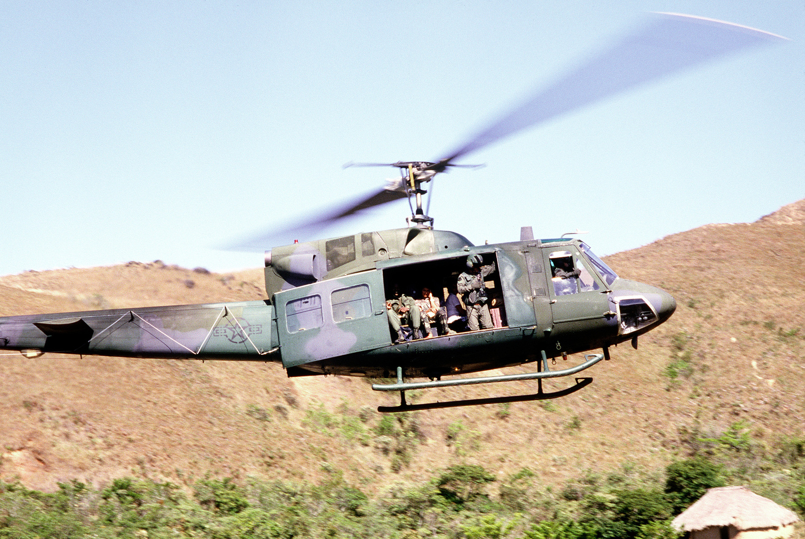 A U.S. Air Force UH-1N Iroquois helicopter transports personnel from Buenos Aires to Guayabito, Panama during a humanitarian aid operation for impoverished Panamanians