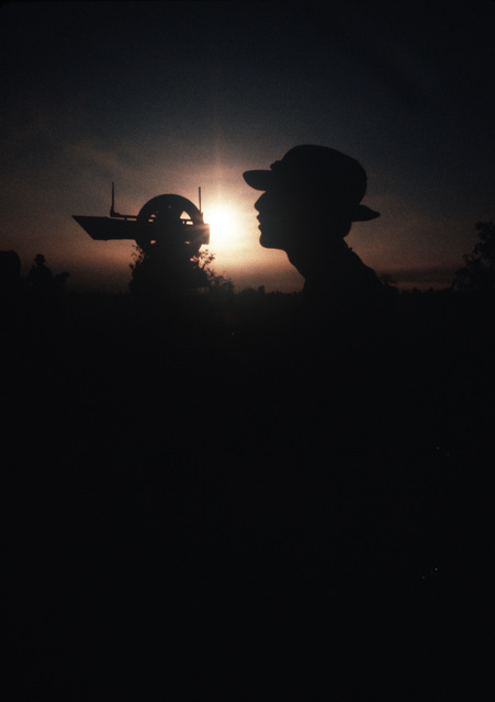 AIRMAN 1ST Class (A1C) Gonzales from Detachment 75, 6th Weather Squadron, Special Operations, uses a theodolite to track a weather balloon during Exercise CABANAS '86