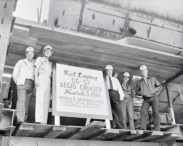 Attending the keel laying of Aegis cruiser (CG 57) at the Ingalls Shipbuilding shipyard are, from left to right: Al Storey, general ship superintendent; Captain (CAPT) Blair Ireland, Aegis area commander; Teno Henderson, program manager, construction; J.D. Taylor, ship coordinator; and Ray Harbrecht, director, ships management