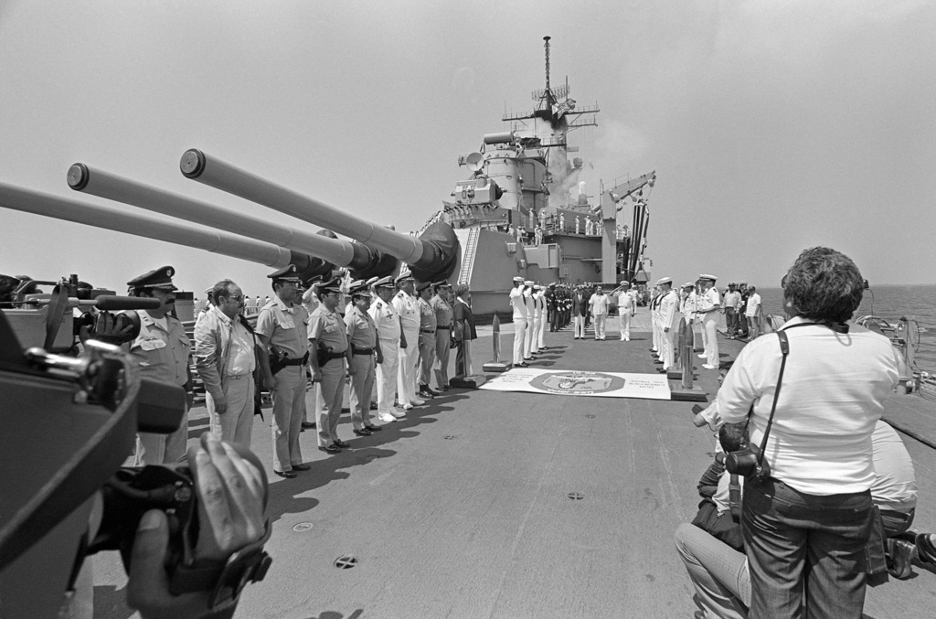 Captain (CAPT) Gerald E. Gneckow, commanding officer of the battleship USS IOWA (BB 61) and Guatemalan President Vinicio Cerezo and Alberto Piedra, US ambassador to Guatemala, review the troops during departure ceremonies for Guatemalan dignitaries