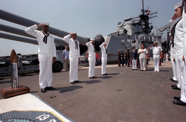 Crew members salute during the departure of Guatemalan Preisdent Vinicio Cerezo from the battleship USS IOWA (BB-61). The IOWA is visiting Guatemala and other countries in Central America in order to establish U.S. interests in the region