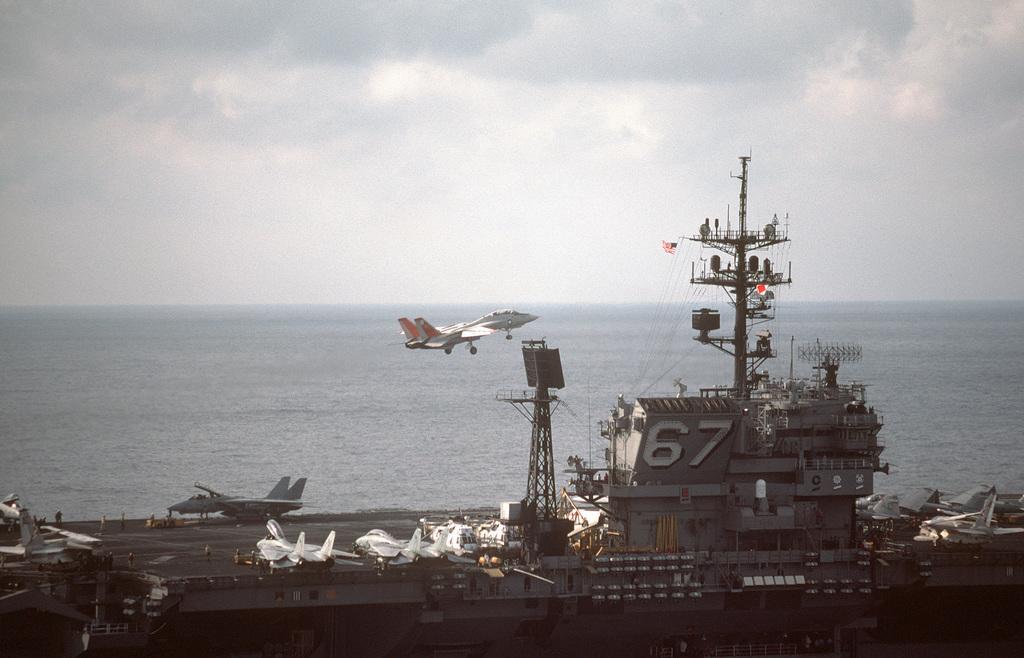An F-14A Tomcat aircraft passes over the flight deck after a wave off from the aircraft carrier USS JOHN F. KENNEDY (CV 67)