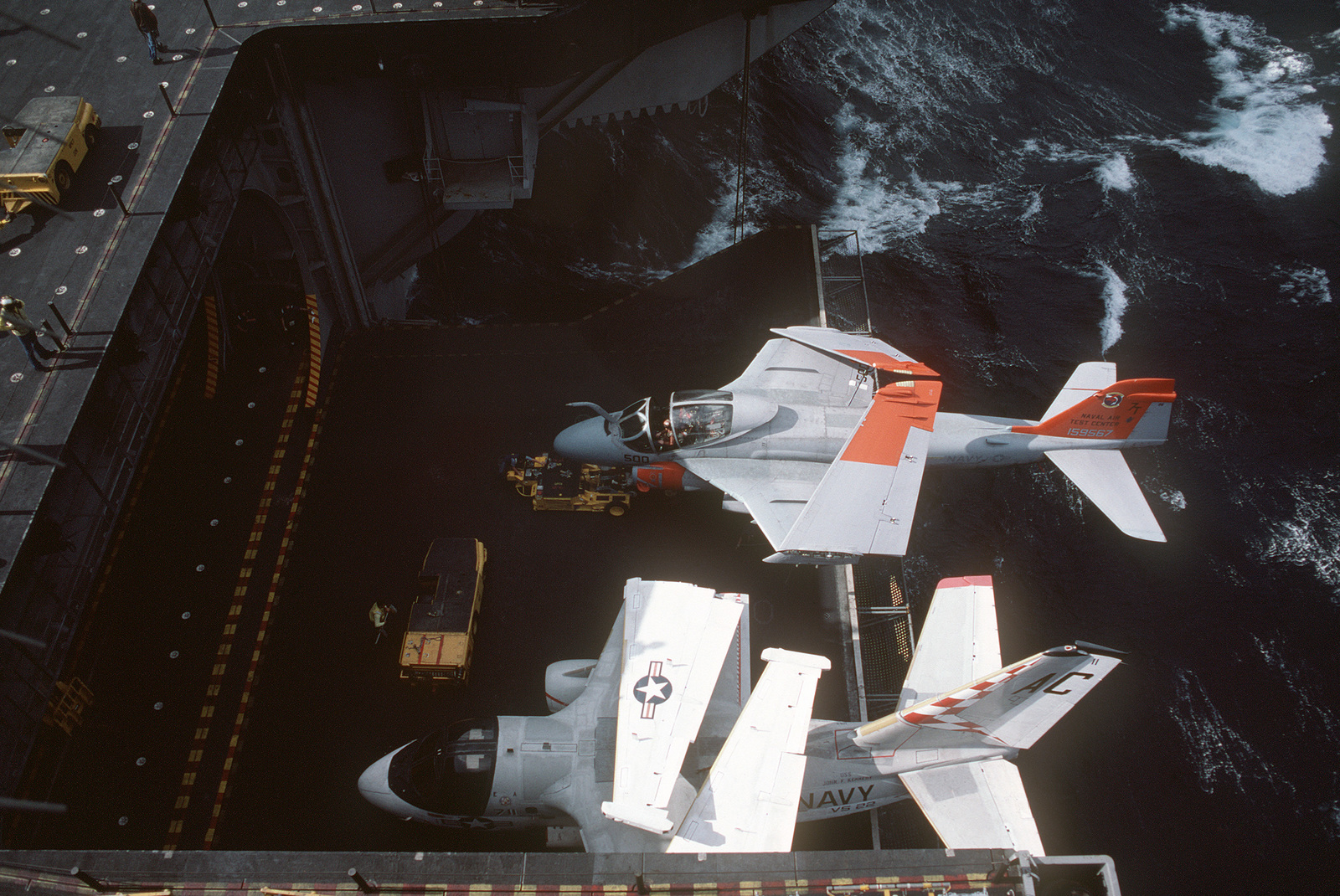 An S-3A Viking aircraft of Air Anti-submarine Squadron 22 (VS-22) and an A-6E Intruder aircraft from the Naval Air Test Center are lowered on an elevator aboard the aircraft carrier USS JOHN F. KENNEDY (CV 67)