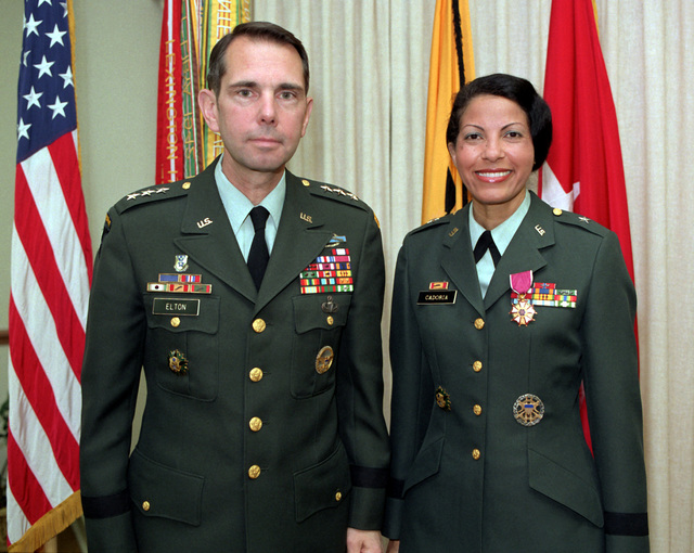 LT. GEN. Robert Elton, deputy chief of staff, personnel, U.S. Army, poses for a photo with Brig. GEN. Sherian Cadoria, the adjutant general, after presenting her with the Legion of Merit. Cadoria was the first Hispanic female officer to be promoted to brigadier general