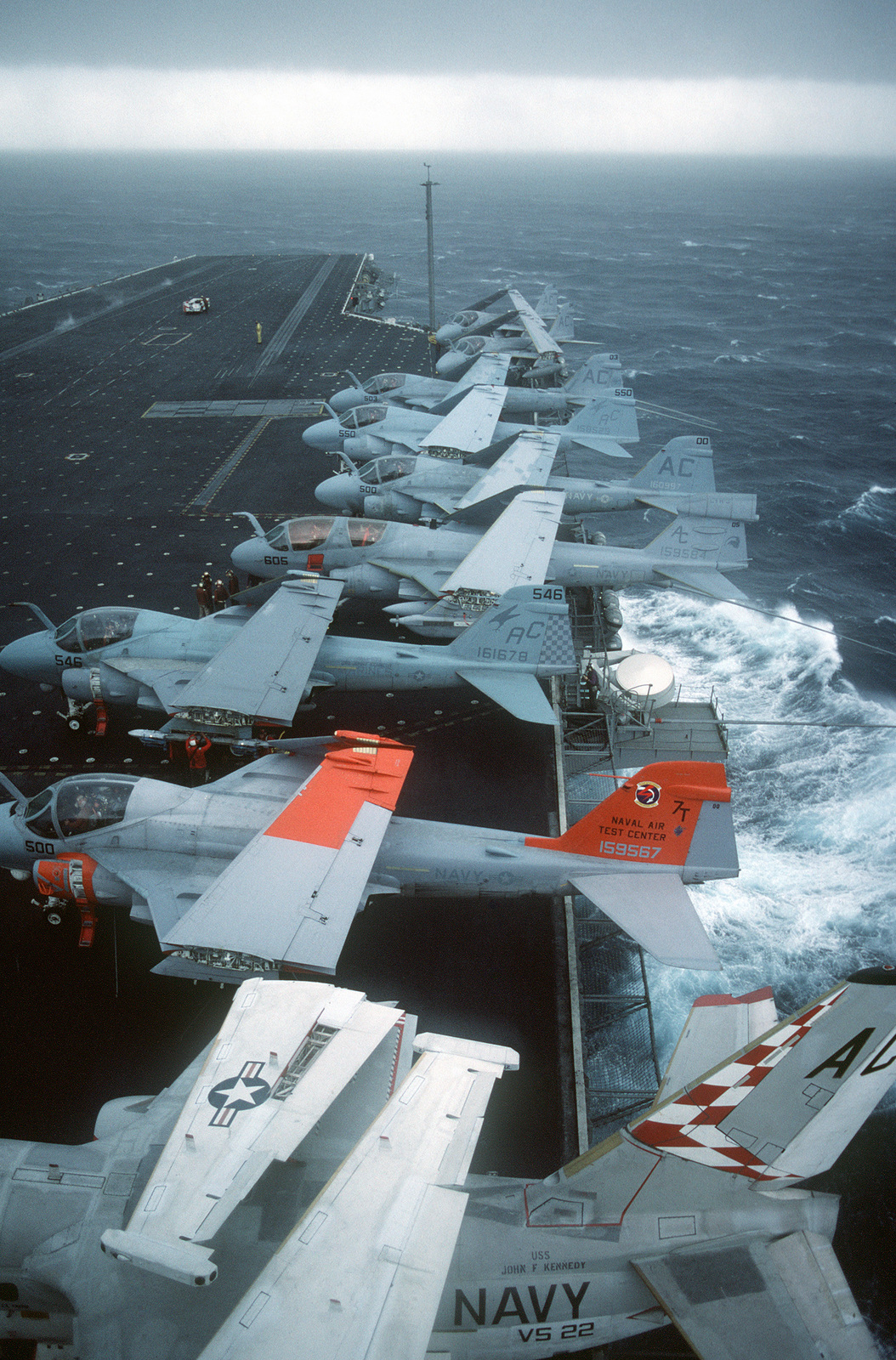 S-3A Viking, A-6E Intruder, and an EA-6B Prowler aircraft are parked on the flight deck of the aircraft carrier USS JOHN F. KENNEDY (CV 67) during a storm