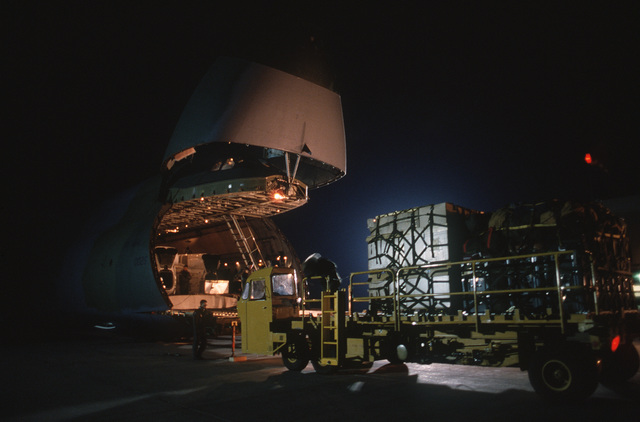 A K-loader is used to load pallets of equipment into a 60th Military Airlift Wing C-5A Galaxy.  The aircraft is picking up elements of a Canadian helicopter squadron assigned to the Multinational Force and Observers.  The C-5A will deliver the squadron to Tel Aviv, Israel