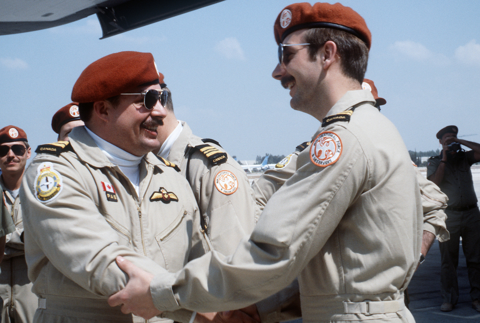 A member of a Canadian advance team welcomes another Canadian military officer to Ben Gurion Airport upon his arrival aboard a 60th Military Airlift Wing C-5A Galaxy.  The aircraft airlifted elements of a Canadian helicopter squadron from Edmonton, Canada, to Israel for duty with Multinational Force and Observers