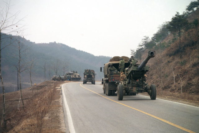 An M198 155 mm Howitzers of the 1ST Battalion, 8th Field Artillery Regiment, 25th Infantry Division, are towed along Highway 44 by an M923 5-ton trucks during the joint US/South Korean Exercise TEAM SPIRIT '86