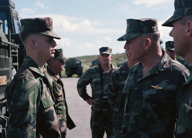General (GEN) P.X. Kelley, commandant of the Marine Corps, inspects Lance Corporal (LCPL) Thomes of Motor Transport Battalion of Marine Wing Service Squadron 172 (MWSS-172) during the general's visit to the base