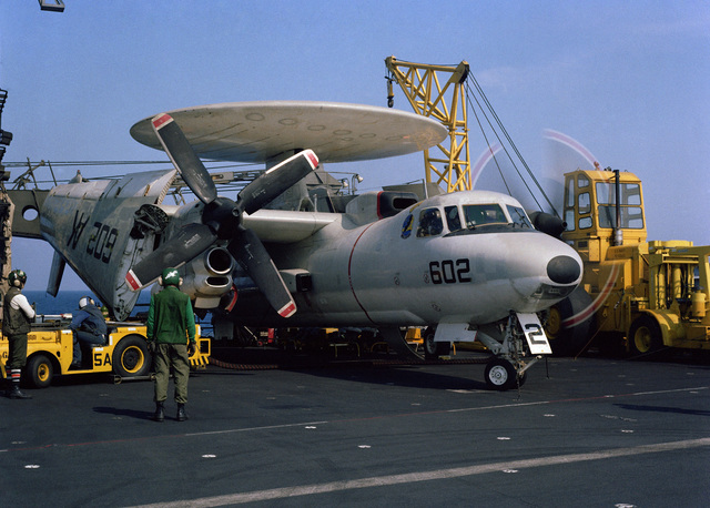 Central Mediterranean Sea.  An Airborne Early Warning Squadron 127 (VAW-127) plane captain aboard the aircraft carrier USS CORAL SEA (CV 43) directs the pilot of a E-2C Hawkeye aircraft to start the right engine during operations near Libya
