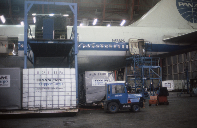 A galley removed from a Boeing 747 aircraft is lowered to the ground on a hydraulic lift. The commercial aircraft, parked beside the lift, is undergoing modification as part of a Military Airlift Command plan to use 115 Boeing and McDonnell Douglas jetliners as air ambulances in the event of war. The aircraft, which would be part of the Civil Reserve Air Fleet, would airlift patients back to the United States