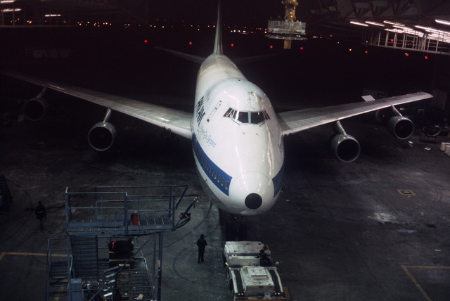 The Sea Serpent, a modified Boeing 747 aircraft, is towed into Pan Am hangar 19. The aircraft has undergone modification as part of a Military Airlift Command plan to use 115 Boeing and McDonnell Douglas jetliners as air ambulances in the event of war. The aircraft, which would be part of the Civil Reserve Air Fleet, would airlift patients back to the United States