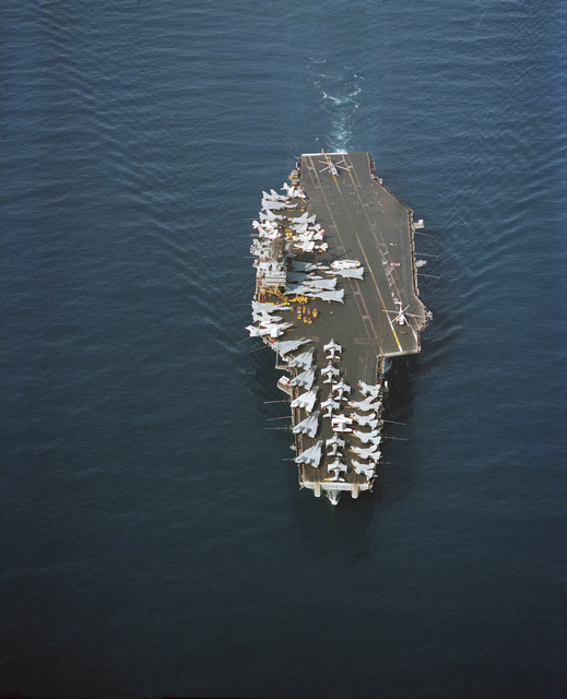 An elevated bow view of the aircraft carrier USS SARATOGA (CV 60) underway