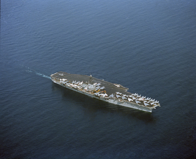 An elevated starboard bow view of the aircraft carrier USS SARATOGA (CV 60) underway
