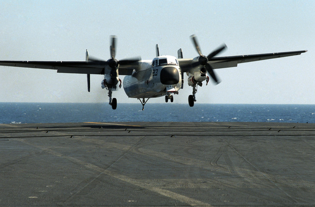 A C-2A Greyhound aircraft approaches for a landing aboard the aircraft carrier USS CORAL SEA (CV 43)