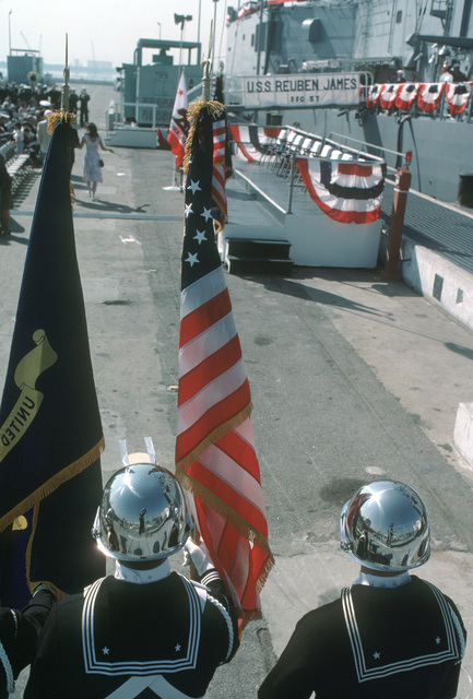 A US Navy color guard stands at attention during the commissioning of the guided missile frigate USS REUBEN JAMES (FFG 57)