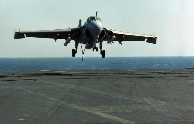 An A-6E Intruder aircraft approaches for a landing aboard the aircraft carrier USS CORAL SEA (CV 43)