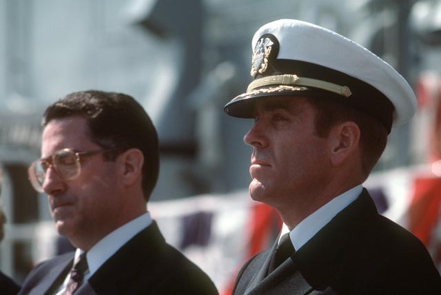 Commander (CDR) John J. Kieley, prospective commanding officer of the guided missile frigate USS REUBEN JAMES (FFG 57), and Secretary of Energy John S. Herrington attend the ship's commissioning