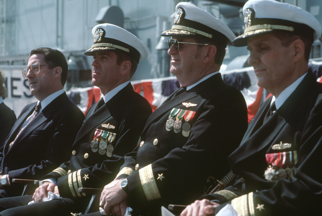 Distinguished guests seated on the speakers platform during the commissioning of the guided missile frigate USS REUBEN JAMES (FFG 57), include, from left to right, Secretary of Energy John S. Herrington; Commander (CDR) John J. Kieley, prospective commanding officer; Rear Admiral (RADM) (lower half) John J. Higginson, commander, Naval Surface Group, Long Beach, California; and RADM Donald P. Roane, deputy commander, Surface Combatants, Naval Sea Systems Command