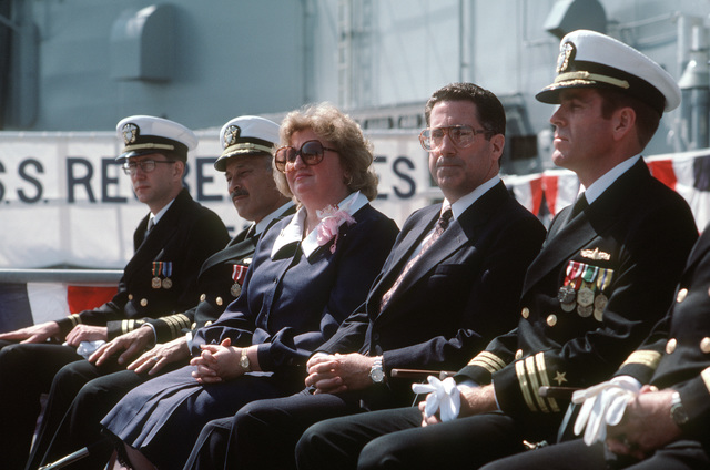 Distinguished guests seated on the speakers platform during the commissioning of the guided missile frigate USS REUBEN JAMES (FFG 57), include, from left to right, Chaplain (LT) George Clifford; Captain (CAPT) Howard Venezia, commander, Surface Squadron One; Lois Haight Herrington, assistant attorney general of the United States; Secretary of Energy John S. Herrington; and Commander (CDR) John J. Kieley, prospective commanding officer