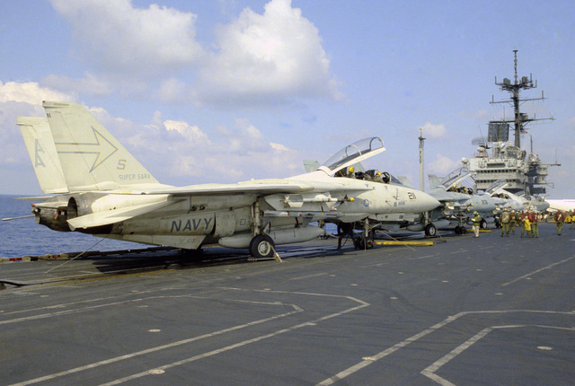 A three-quarter right rear view of a Fighter Squadron 103 (VF-103) F-14A Tomcat aircraft on the flight deck of the aircraft carrier USS SARATOGA (CV 60)