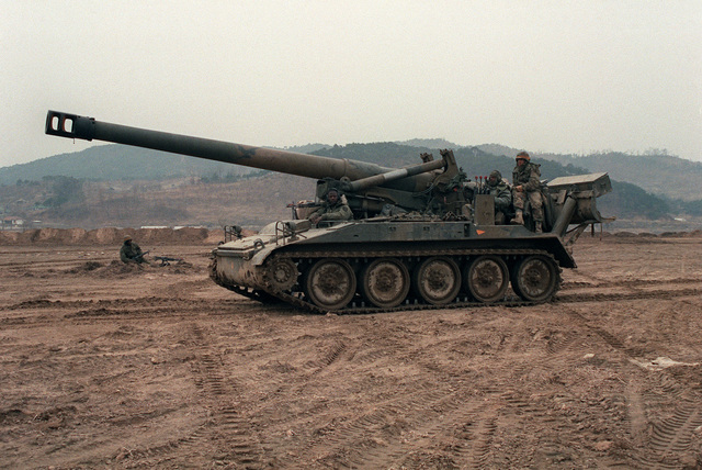 An M-110A2 8-inch howitzer of Battery A, 6th Bn., 37th Field Artillery, is moved into position for a firing mission near the South Han River during the joint U.S. and South Korean Exercise Team Spirit '86