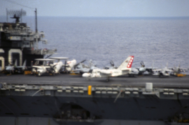 An S-3A Viking aircraft lands aboard the aircraft carrier USS SARATOGA (CV 60) during flight operations off the coast of Libya. Third view in a series of three. (SUBSTANDARD)