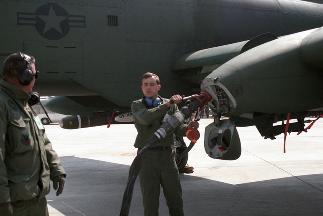 A ground crewman refuels a US Air Force A-10A Thunderbolt II aircraft on a highway during the joint US and South Korean Exercise TEAM SPIRIT '86. The highway is being used by various aircraft for emergency landing training