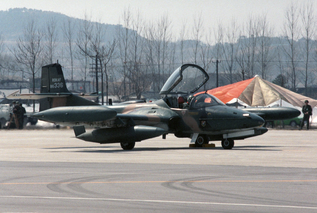 A South Korean air force A-37B Dragonfly aircraft is parked on a highway during the joint US and South Korean Exercise TEAM SPIRIT '86. The highway is being used by various aircraft for emergency landing training