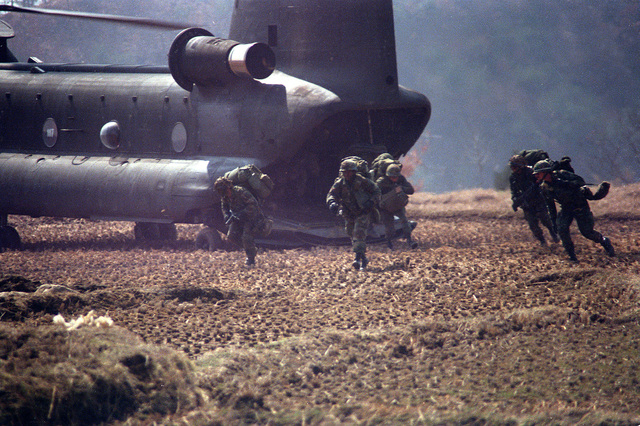 Soldiers of the 1ST Bn., 35th Inf., 25th Inf. Div., exit from a CH-47 Chinook helicopter while participating in an air assault during the joint U.S./Korean Exercise Team Spirit '86