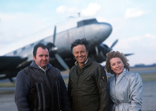 Posing for a photograph in front of a C-47 Skytrooper aircraft are, from left to right: Ron Fox, current operator of the aircraft; Alan Morris, a retired British Airlines pilot; and Frieda Hyles, personal representative of Jim Cullens, buyer and donator of the C-47. The aircraft will be restored and put on display at the Berlin Airlift Memorial