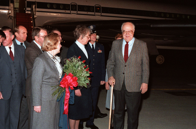 Soviet Ambassador to the United States Anatoliy F. Dobrynin and his wife are greeted upon their arrival by general officers and state officials