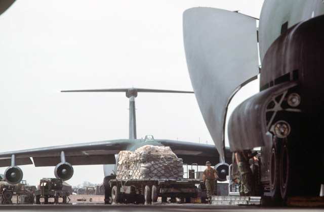 A cargo pallet loaded with humanitarian aid transported by the 14th Military Airlift Squadron is unloaded from a C-141B Starlifter aircraft.  The supplies were donated to Hondurans from private relief agencies in the United States