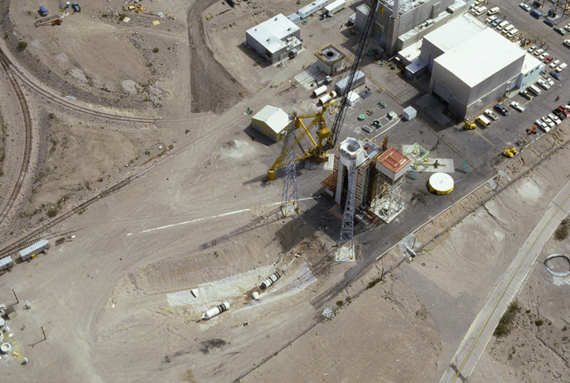 An aerial view of an LGM-118A Peacekeeper intercontinental ballistic missile in an impact pit after being fired from a launch tube at the Mercury Proving Grounds