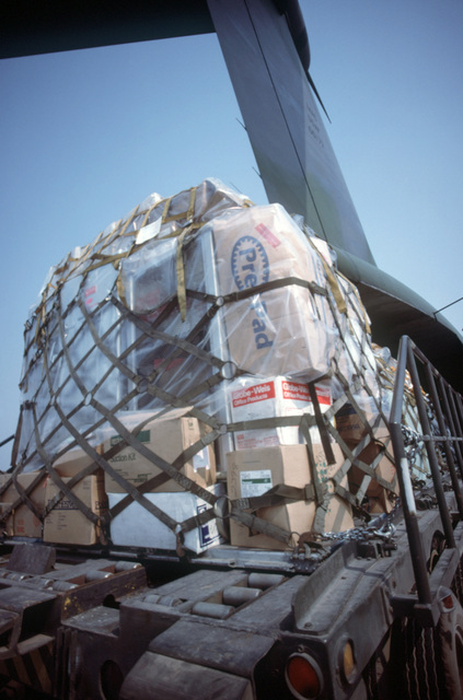 Medical equipment and other supplies are unloaded from a 14th Military Airlift Squadron C-141B Starlifter aircraft.  The humanitarian assistance supplies were donated by private relief agencies in the United States