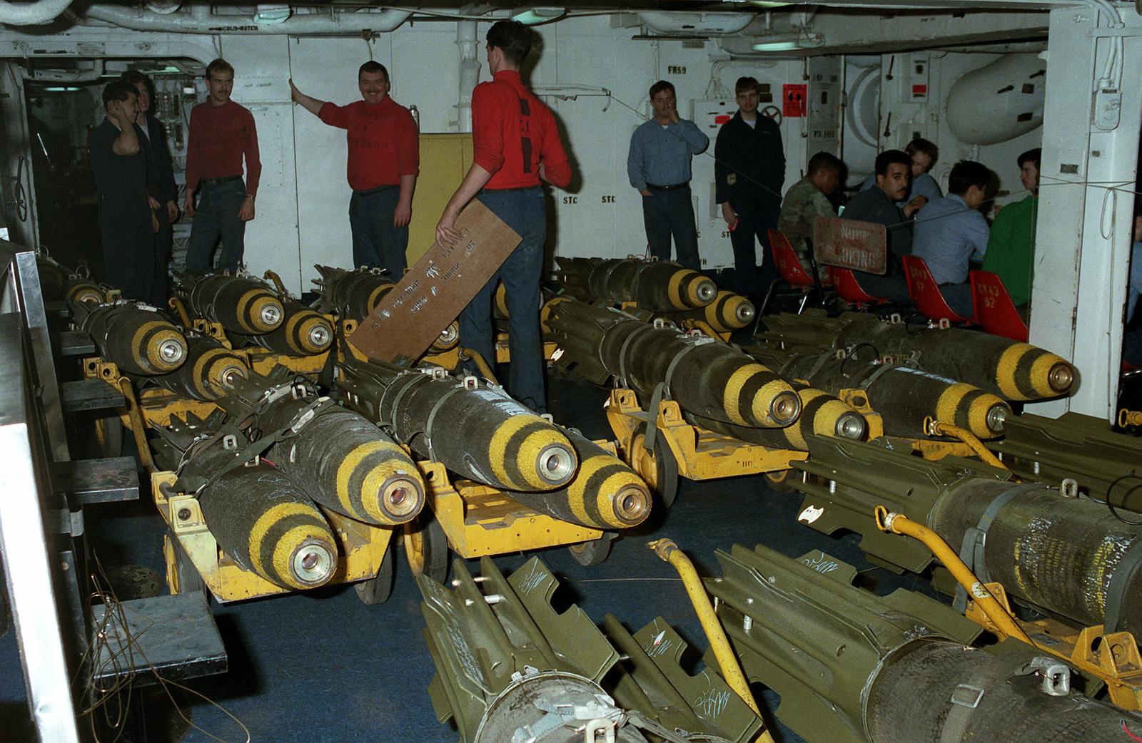 Aviation ordnancemen stencil messages on Mark 82 500-pound
