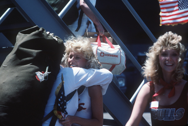 A sailor from the aircraft carrier USS SARATOGA (CV 60) greets a loved one upon the ship's return to port from a deployment to the Mediterranean Sea