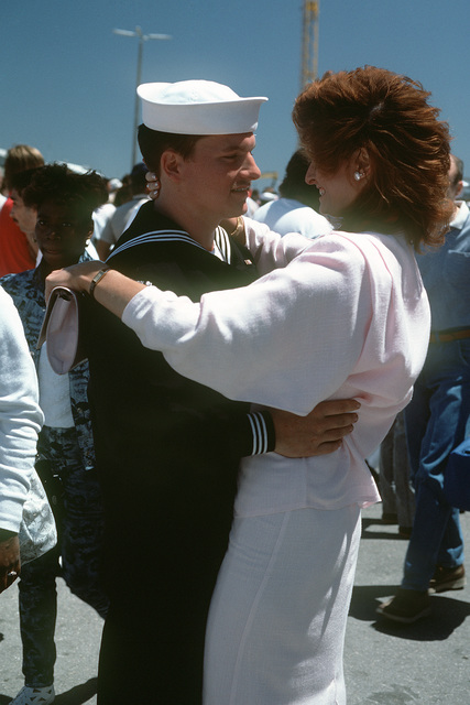 A sailor greets a love one upon his return to port aboard the USS SARATOGA (CV 60). The ship has just returned from a deployment to Mediterranean Sea