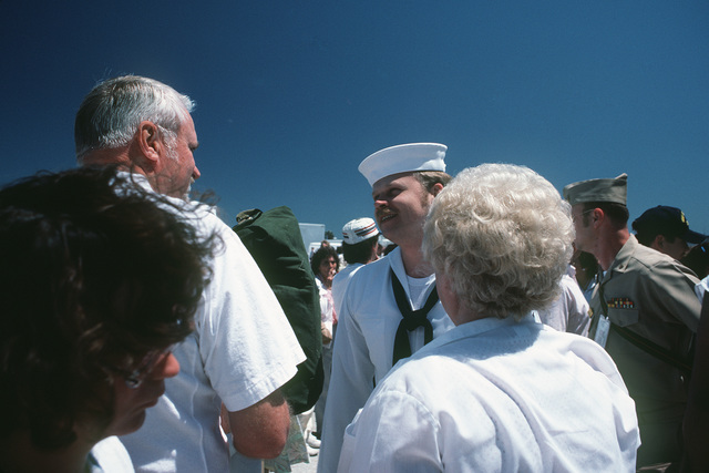 A sailor greets his family upon his return to port aboard the aircraft carrier USS SARATOGA (CV 60). The ship has just returned from a deployment to the Mediterranean Sea