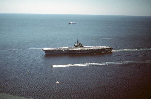 An elevated port view of the aircraft carrier USS SARATOGA (CV 60) returning to port after a deployment to the Mediterranean Sea