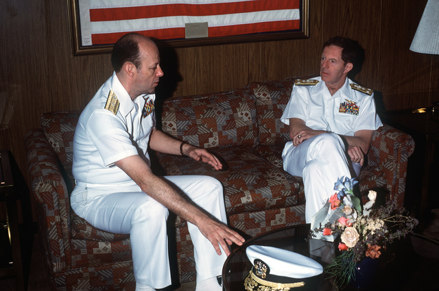 Rear Admiral (lower half) David M. Bennett, deputy commander, Naval Surface Force, US Atlantic Fleet, confers with Vice Admiral Robert F. Dunn, commander, Naval Air Force, US Atlantic Fleet, while aboard the aircraft carrier USS SARATOGA (CV 60). The ship has just returned to port after a deployment to the Mediterranean Sea