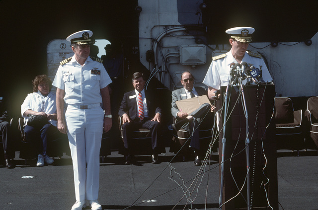 Vice Admiral (VADM) Robert F. Dunn, commander, Naval Air Force, US Atlantic Fleet, speaks during an arrival ceremony for the aircraft carrier USS SARATOGA (CV 60). The ship has just returned to port after a deployment to the Mediterranean Sea. On the left is Captain (CAPT) Jerry Unruh, commanding officer of the SARATOGA