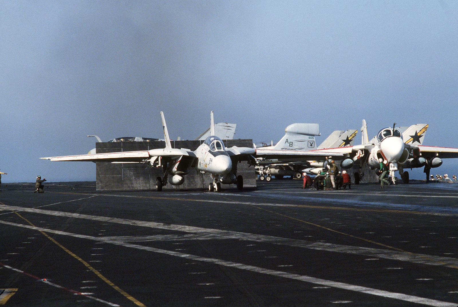 An F-14A Tomcat aircraft, left, and an A-6E Intruder aircraft prepare to take off from the aircraft carrier USS AMERICA (CV 66) during flight operations off the coast of Libya