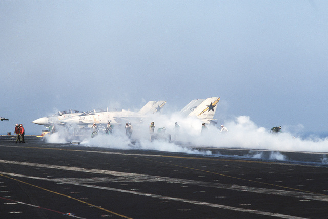 Steam rises from catapults aboard the aircraft carrier USS AMERICA (CV 66) during flight operations off the coast of Libya
