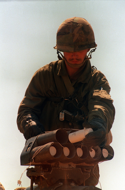 A soldier loads rounds in a Hoffman detonator training device in preparation for an exercise at the U.S. Army Armor Center