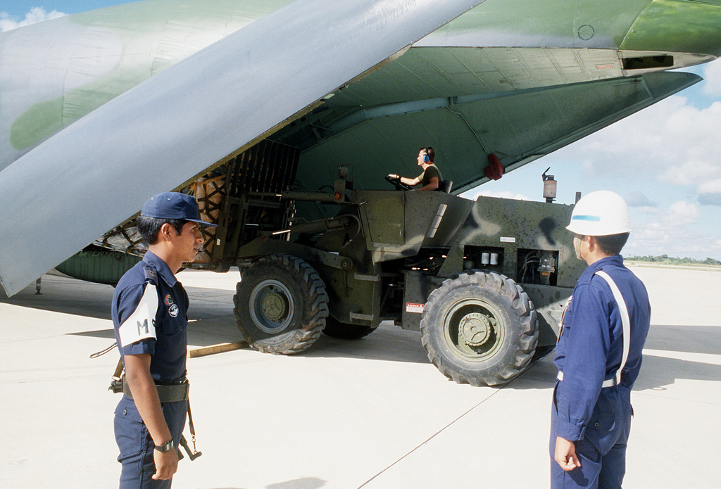 An airman uses a fork lift truck to unload a 20th Military Airlift Squadron C-141B Starlifter aircraft at Viru Viru Airport during Fuerzas Unidas Bolivia, a joint U.S. and Bolivian training exercise