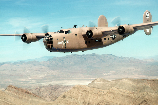 "An air-to-air left front view of a B-24 Liberator aircraft flying in an air show held during the Air Force Association's ""Gathering of Eagles,"" a convention commemorating spectacular achievements in the free world's aerospace development"