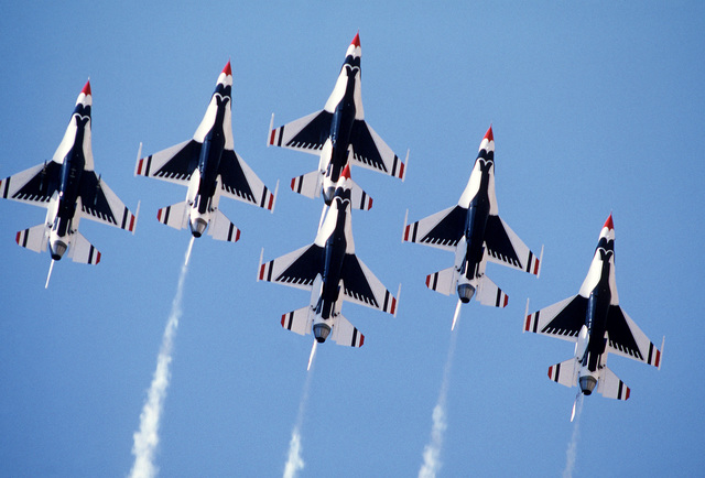 "An underside view of six F-16 Fighting Falcon aircraft of the USAF Thunderbirds Aerial Demonstration Team in a delta formation during an air show. The air show is one of many events held during the Air Force Association's ""Gathering of Eagles,"" a convention commemorating spectacular achievements in the free world's aerospace development"