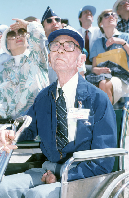 """Jake Eierman, one of the original Doolittle Raiders, watches a firepower demonstration during the Air Force Association's Gathering of Eagles,""""a convention commemorating spectacular achievements in the free world's aerospace development"""